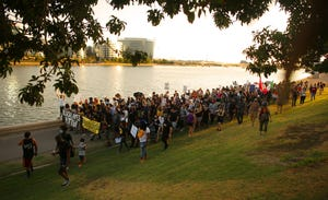 Black Lives Matter protesters make their way along the north side of Tempe Town Lake toward Scottsdale Road during a protest at Tempe Beach Park in Tempe on July 27, 2020.