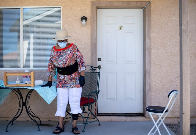 A portrait of Sharon Rashad in front of her Arizona City apartment on July 28, 2020.