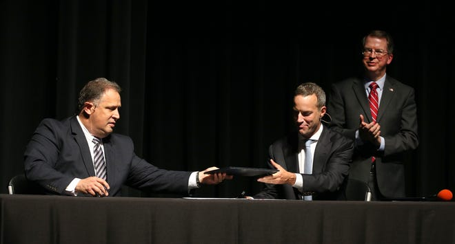 Kodak CEO Jim Continenza, left, and DFC CEO Adam Boehler sign an agreement in which Kodak will take part in manufacturing pharmaceuticals in response to the coronavirus.
