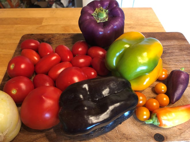A selection of ripe tomatoes and peppers from the garden of master gardener and columnist Leimone Waite.