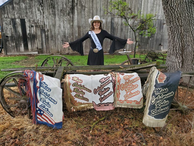 Kelsee French shows off her rodeo memorabilia.