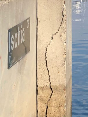 Cracks are seen on a seawall at Channel Islands neighborhood in Oxnard.