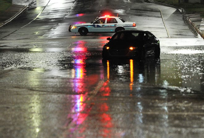 Wichita Falls police emergency crews respond to a report of a possible water rescue Monday night after heavy rain moved across the city leaving some motorists stranded around town.