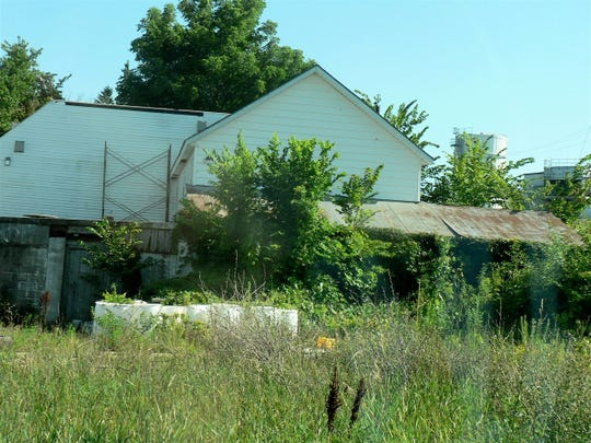 The Health Valley cheese factory across the highway from Grande Cheese in Juda served as a home, but is now vacant and overgrown.