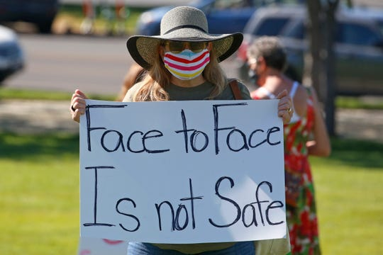 Kris Reddout, a 5th grade teacher, attends a Utah Safe Schools Mask-In urging the governor's leadership in school reopening during a rally Thursday, July 23, 2020, in Salt Lake City.