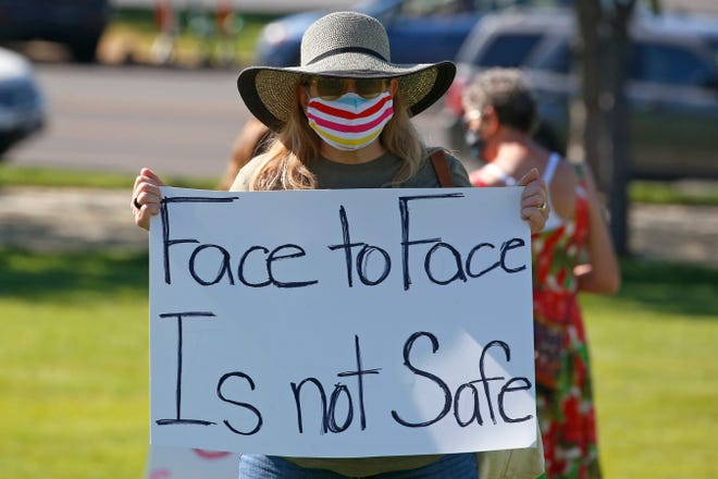 Kris Reddout, a fifth grade teacher, attends a Utah Safe Schools Mask-In urging the governor's leadership in school reopening during a rally July 23 in Salt Lake City.