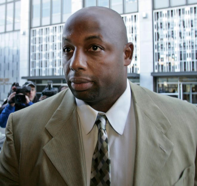 Former NFL football player Dana Stubblefield, front, leaves a federal courthouse on Jan. 18, 2008.