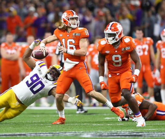 Clemson quarterback Trevor Lawrence (16) throws a pass against LSU during the first half in the College Football Playoff national championship game at Mercedes-Benz Superdome.
