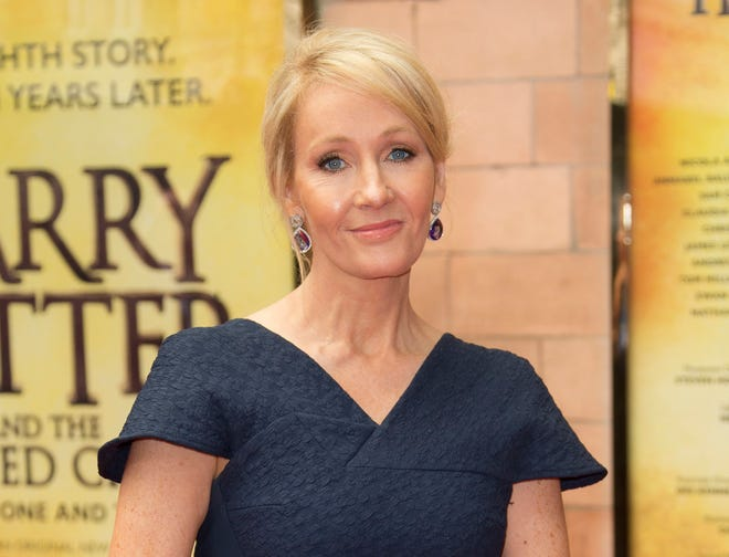 """In this July 30, 2016 file photo, writer J.K. Rowling poses for photographers upon arrival at gala performance of """"Harry Potter and the Cursed Child,"""" in central London."""