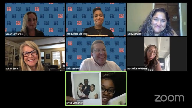 Kyila Crutcher shows panelists at a virtual town hall on Tuesday a picture of her father, who has been incarcerated for the majority of her life. The panelists included several activists pushing for criminal justice reform in Oklahoma.