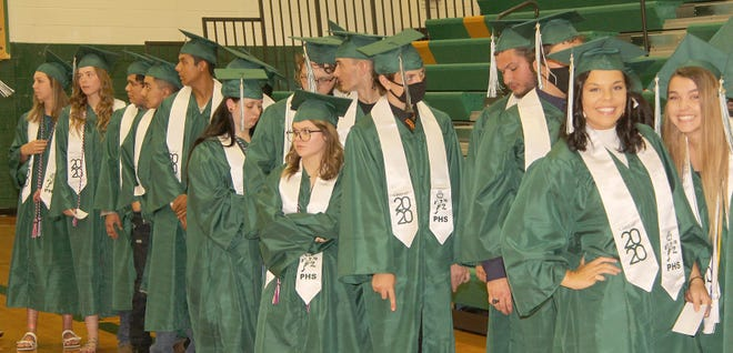 Pratt High School seniors of 2020 line up as they get ready to leave the Liberty Middle School gym and head over to their graduation ceremony in the high school