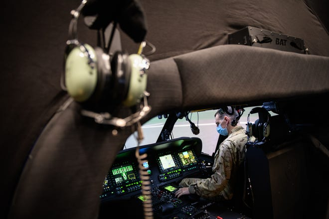 1st Lt. Don Weeks prepares to use the new Black Hawk Aircrew Trainer, referred to as BAT, on Wednesday on Simmons Army Airfield. The simulation device came to Fort Bragg in January, replacing the older UH-60A/L simulator.