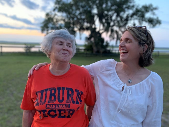 Linda Shaw shares a laugh with her daughter, Hayley Hutchison as the sun sets over Crooked River in Georgia.