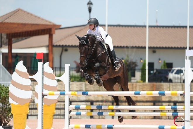 Melbourne resident Alexis Halbert and her horse, Charisma, compete in June at the Tryon International Equestrian Center in Mill Spring, North Carolina.