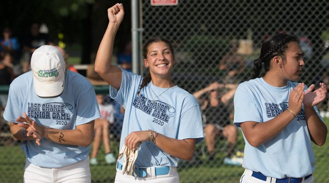 Buena's  Bridgette Gilliano, center, cheers as players are announced prior to the Senior Last Chance softball game played in Washington Township on Tuesday, July 28, 2020.