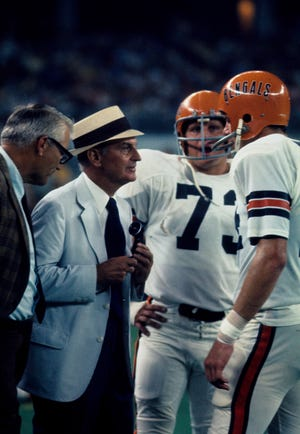 Sep 1970; Unknown Location; FILE PHOTO; Cincinnati Bengals head coach Paul Brown speaks to guard Pat Matson (73) and Sam Wyche (right) on the sideline during the 1970 season.