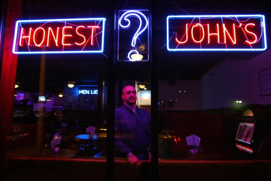 John Thompson, then 48, is shown in the  Honest Johns at the corner of Second and Selden in Midtown in this file photo..