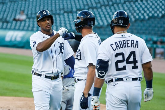Tigers second baseman Jonathan Schoop fist bumps center fielder JaCoby Jones after hitting a two-run home run against the Royals during the third inning at Comerica Park on Tuesday, July 28, 2020.