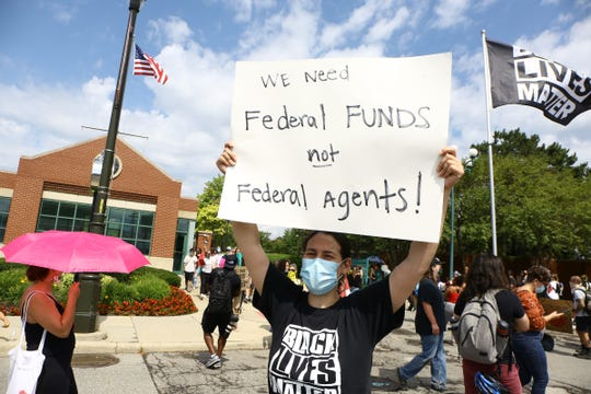 Protesters rally outside of the U.S. Alcohol Tobacco and Firearms building between Gratiot Avenue and Russell Street as a press conference is being held inside the building on federal agents coming to Detroit.