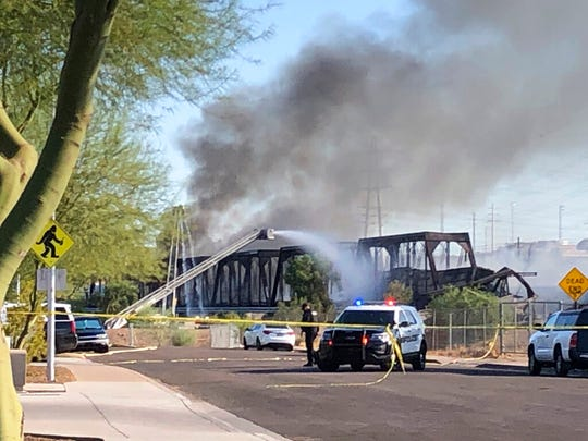 Firefighters respond to the scene of a train derailment in Tempe, Ariz.,Wednesday, July 29, 2020.