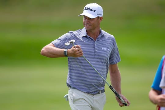 Nick Watney smiles after a birdie during the first round of the 3M Open golf tournament Thursday in Blaine, Minn.