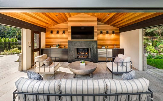 Interior designer Jill Schumacher and her firm, Rariden Schumacher Mio, worked on this outdoor space in Bloomfield Hills for a couple who likes to entertain. The furniture is from Kannoa, Century & Mr. Brown. The fireplace surround and flanking countertops were made locally by Line Studio.