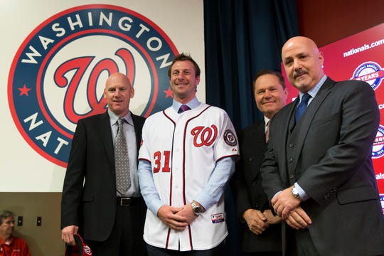 Nationals pitcher Max Scherzer, second from left, poses for photographs during an introductory news conference in 2015 in Washington. Scherzer signed a $210 million, seven- year contract to join the Nationals.