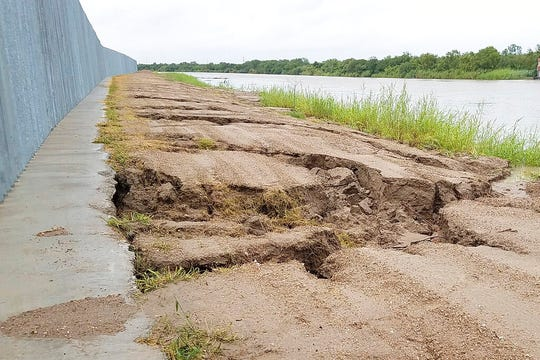 This Sunday, July 26, 2020, photo provided by the National Butterfly Center, shows damage caused by Tropical Storm Hanna at the Fisher border wall, a privately funded border fence on the Rio Grande River near Mission, Texas.