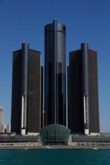 A general view of the Renaissance Center, headquarters for General Motors, is shown along the Detroit skyline from the Detroit River, Tuesday, May 12, 2020. (AP Photo/Paul Sancya)