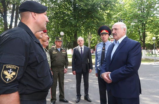Belarus President Alexander Lukashenko, right, speaks with officers as he visits the Belarusian Interior Ministry special forces base in Minsk, Belarus, Tuesday, July 28, 2020. The presidential election in Belarus is scheduled for Aug. 9, 2020.