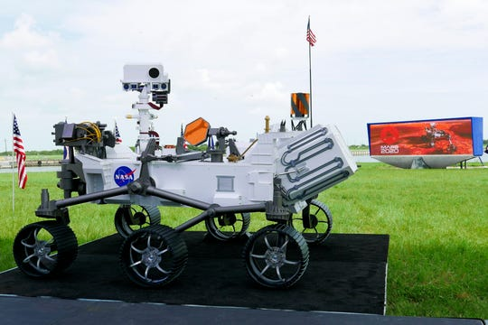 A replica of the Mars rover Perseverance is displayed outside the press site before a news conference at the Kennedy Space Center Wednesday, July 29, 2020, in Cape Canaveral, Fla.
