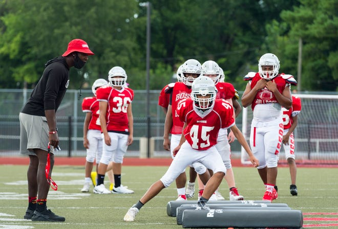 Bosse's head Coach DaMarcus Ganaway encourages his players during practice at Enlow Field Tuesday evening, July 28, 2020.
