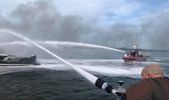 Fire destroyed a boat north of Cabbage Key Wednesday morning.