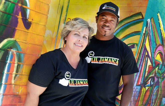Lil Jamaica owners Janel Johnson and Derron Wilson opened their new lounge in Green Bay on July 24 but have been serving from their food truck of the same name since last fall.