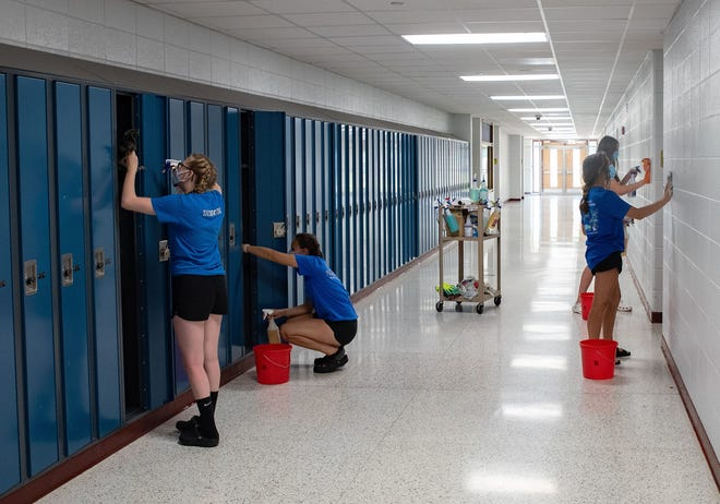 Summer workers at Oconto High School work on cleaning the lockers and walls on July 28. From left are  Breanna Duncan, Nevaeh Brill, Brooklyn Rasmussen and Emmy Reed.