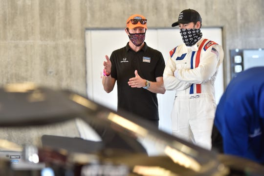 Seven-time NASCAR series champion Jimmie Johnson (right) tested an Indy car for the first time Tuesday, with the help of Chip Ganassi Racing veteran Scott Dixon.