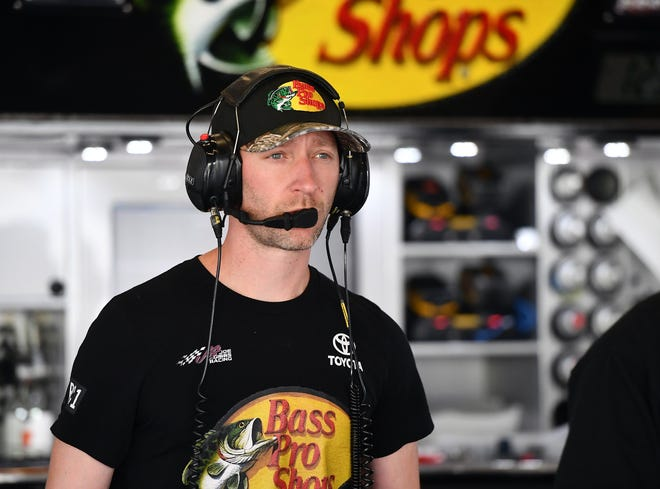 Feb 15, 2019; Daytona Beach, FL, USA; Cole Pearn crew chief for NASCAR Cup Series driver Martin Truex Jr. (not pictured) seen in the garage area during practice for the Daytona 500 at Daytona International Speedway.