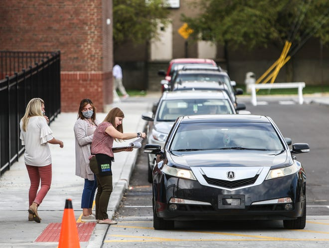Cars line up for morning drop-off at Franklin Square Elementary in Jeffersonville on July 29. The drop-offs were staggered to help with social distancing.