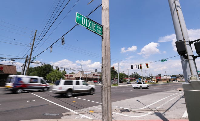 Two people were killed and several more were injured after a stolen car pursued by Shively Police hit two other vehicles at the intersection where Crums Lane, Seventh Street and Dixie Highway converge on Tuesday.