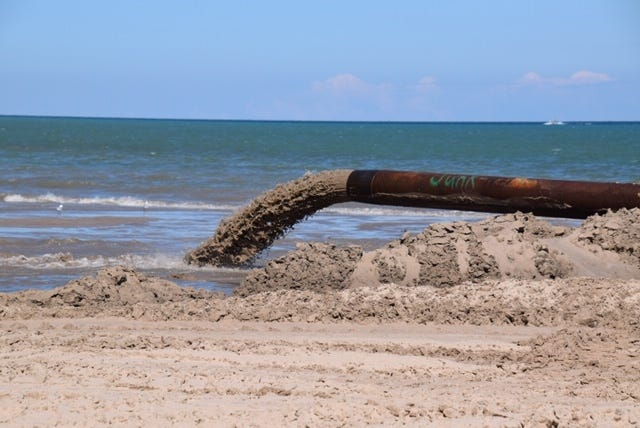 Sand dredged from Lake Michigan creates a new beach in Two Rivers.