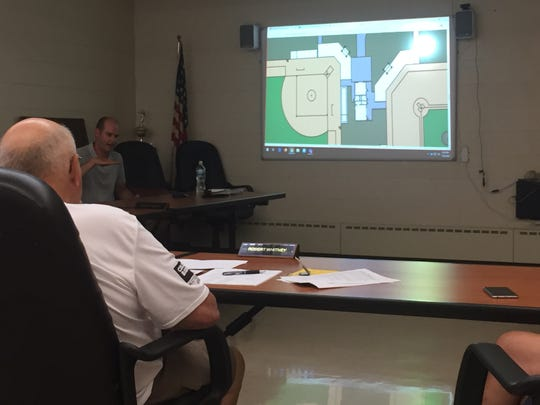 Lexington school board members listen to an update on the district's 7-12 building at a special meeting Tjuesday.