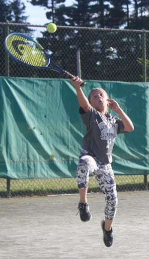 Brooklyn Parks, 9, of Lexington reaches for a shot en route to winning the girls 9-and-under singles title over Raina Wood on Tuesday in the 87th News Journal/Richland Bank Tennis Tournament at Lakewood Racquet Club.