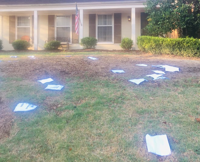Flyers litter the yard of Shelby County Commission Chairman Mark Billingsley.