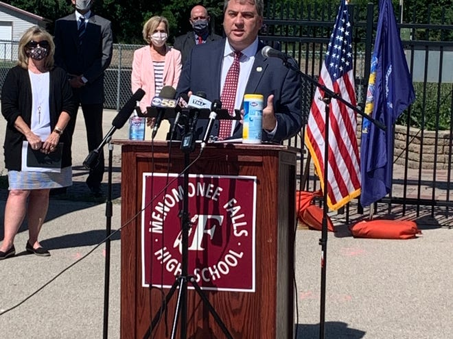 Waukesha County Executive Paul Farrow speaks to the media at Menomonee Falls High School July 29 about a partnership between the county and area school districts to reopen schools safely.