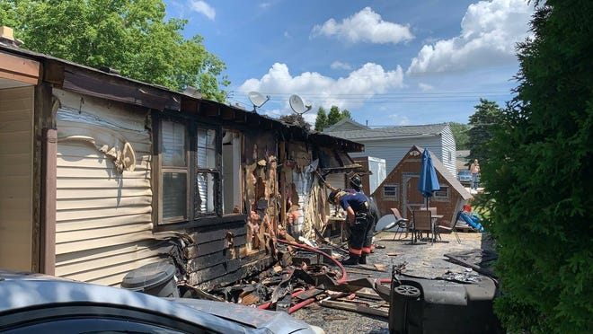 The Greenfield Fire Department received assistance from four neighboring departments in battling a fire at this home on 92nd Street in Greenfield on July 26. One firefighter was injured and a dog was rescued from the home. Officials say improper disposal of smoking materials caused the fire.