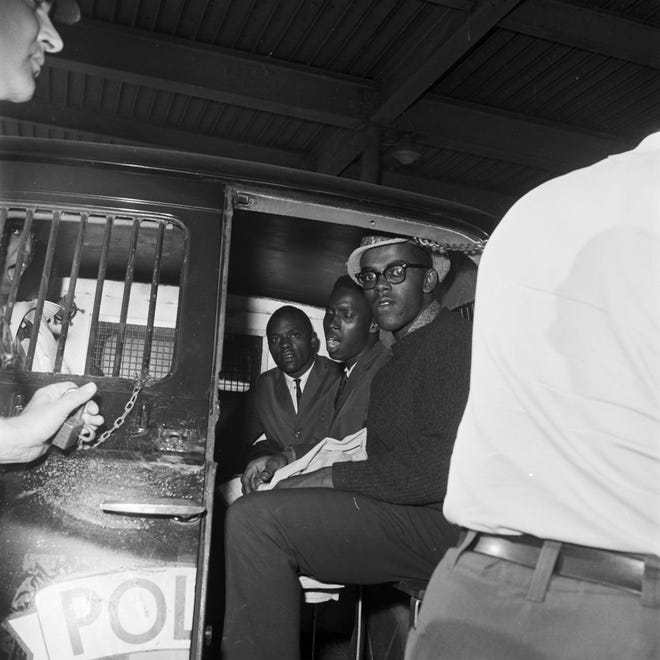 Arrested Freedom Riders in the back of a police van after their arrival at the Greyhound station in Birmingham, Alabama in May, 1961.