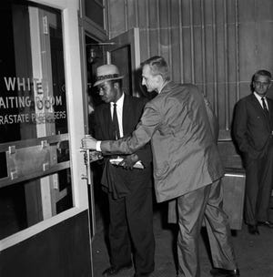 Freedom riders Jim Zwerg and Paul Brock entering the white waiting room for intrastate passengers at the Greyhound bus station in Birmingham, Alabama.