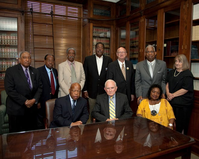 "U.S. Rep. John Lewis, D-Ga., and former Alabama Gov. John Patterson following a lunch at the Frank M. Johnson Federal Courthouse Complex on May 20, 2011. In the back row (left to right): Freedom Riders Bernard Lafayette; Bill Harbour; Matthew Walker; Hank Thomas; Jim Zwerg; Earnest ""Rip"" Patton, and Margaret Leonard. Freedom Rider Catherine Burks Brooks is seated to Patterson's left."