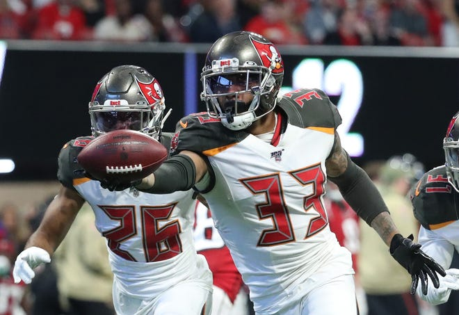 Tampa Bay Buccaneers cornerback Carlton Davis (33) celebrates an interception against Atlanta Falcons wide receiver Calvin Ridley (not pictured) in the third quarter at Mercedes-Benz Stadium. on Nov. 24, 2019.