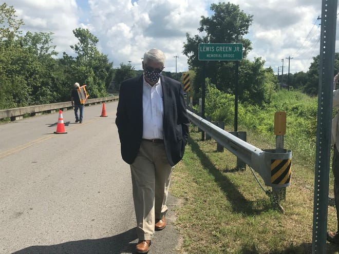 Williamson County Mayor Rogers Anderson walks along Nolensville Park Road during the unveiling ceremony of Lewis Green Jr. Bridge, named for the late commissioner.